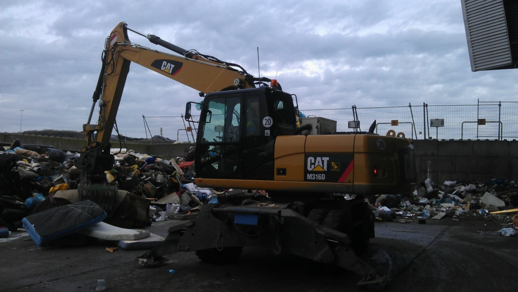 Household waste Caterpillar M316D wheeled excavator  with Arctic air Cab pressurizer.