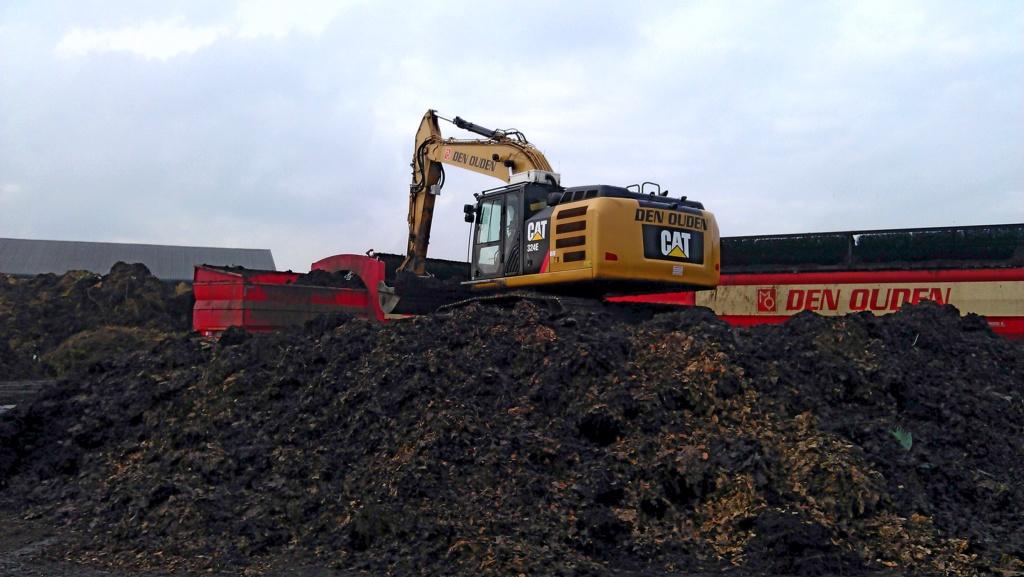 Composting Caterpillar 324E excavator with Arctic Air clean cab system.