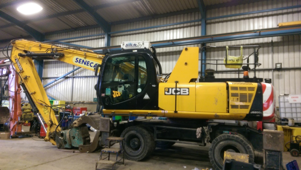JCB JS200W fitted with an Arctic Air clean air filtration overpressure safety system